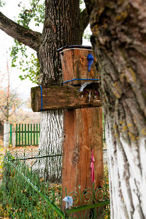 pious: the old wooden cross, located in the village. Belarus