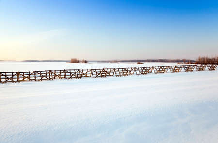 snowlandscape: covered with white snow , snow-covered ,  field in winter Stock Photo