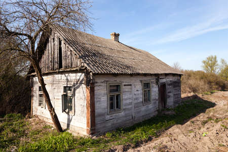 abandoned farmhouse abandoned farmhouse: an abandoned collapsing wooden farmhouse, close up Belarus. Stock Photo