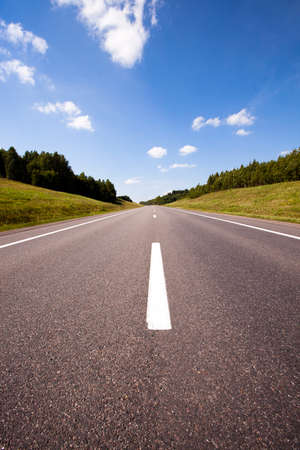 rural areas: the small asphalted road which is in rural areas. Belarus Stock Photo