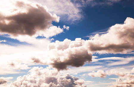 stratus: white cumulus clouds with blue sky. photo taken in autumn