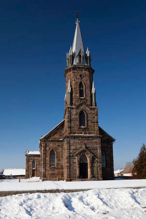 reverent: a small rural Catholic Church, photographed close-up