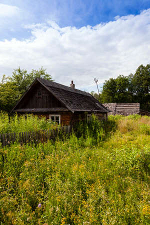 godforsaken: abandoned house - old wooden abandoned house.It located in the countryside. Belarus. Stock Photo