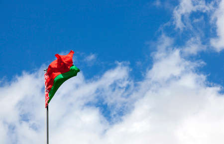 lacerated: photographed closeup of the flag of Belarus. blue sky. ragged old flag Stock Photo