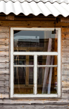 chimney corner: an old wooden house, photographed in Belarus