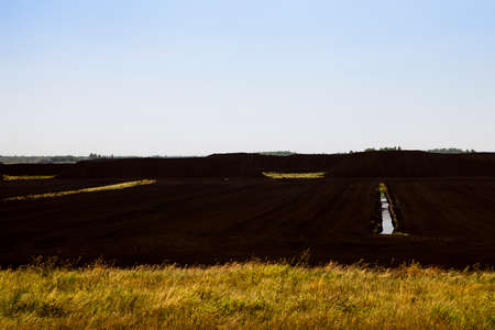 turf bog: photo of the field, which is collected peat, autumn season