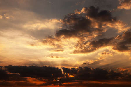 reveille: photographed close up the sky during sunset soltse colored clouds, defocused