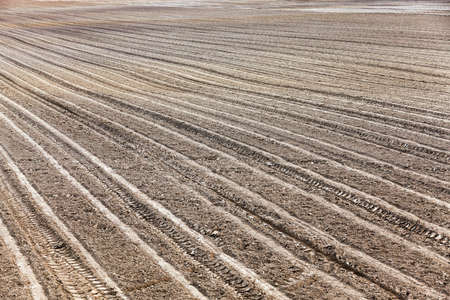 featureless: plowed agricultural field for sowing. Spring. Belarus Stock Photo