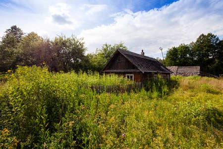 godforsaken: old wooden abandoned house.It located in the countryside. Belarus. Stock Photo