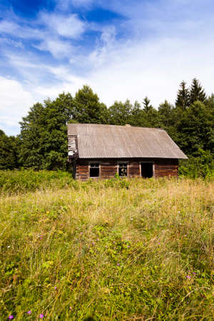 old wooden abandoned house.It located in the countryside. Belarus. Stock Photo