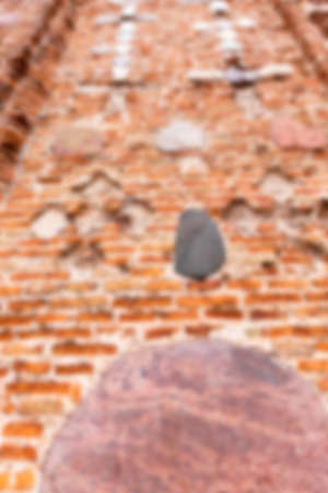 crumbling: photographed close-up of the old church, crumbling wall, defocused