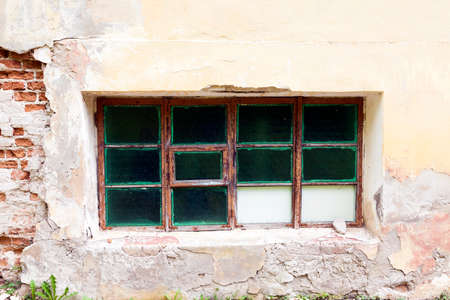 boarded: boarded up window in an old abandoned building, close-up, Stock Photo