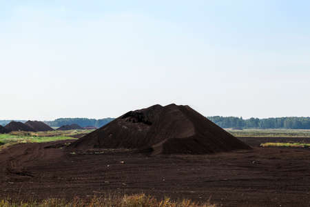 an area in which production is carried black peat, peat mountains Stock Photo