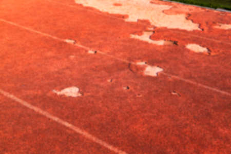 holey: the road for a run in the stadium, there are a number of defects on the road, defocus