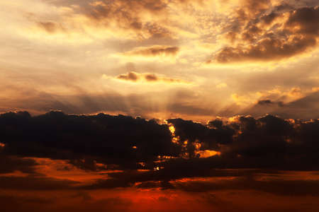 reveille: photographed close up the sky during sunset  colored clouds, defocused