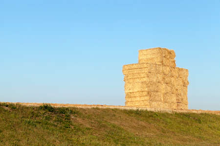 remained: an agricultural field, which remained Straw Haystacks after wheat harvest