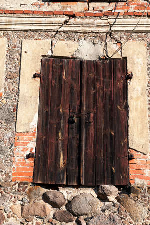 boarded: photographed close-up of old building with boarded and the doors and windows closed Stock Photo