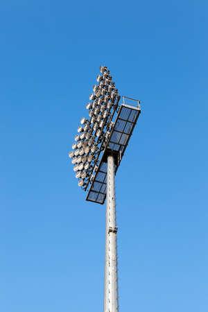 lighting equipment, mounted on a pole. location - the stadium, blue sky Stock Photo