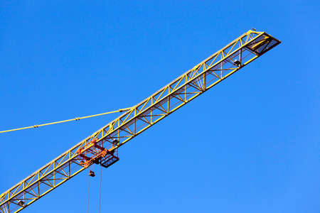 public housing: photographed close-up construction cranes during construction of a new multi-storey residential building