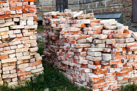 photographed close-up of old red bricks, remaining after the destruction of the building