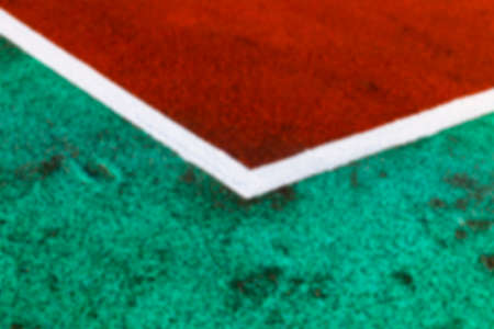 level playing field: photographed close-up of the old treadmill orange on stadium, Defocus