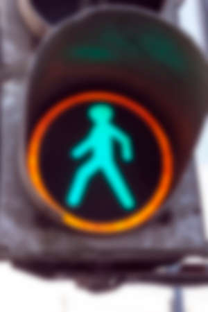 regulate: photographed close-up of a traffic light to regulate traffic at the intersection, defocus