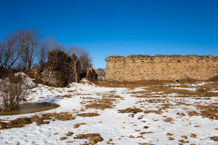 the ruins of an ancient fortress , the wall, is located in the village of Krevo. Belarus. Winter season