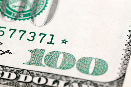 monies: photographed close-up of American paper money worth one hundred dollars, the new American bil Stock Photo