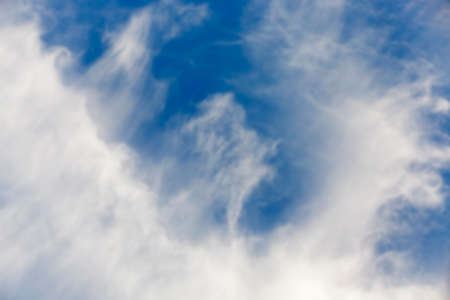 photographed close-up of a blue sky, where the clouds are