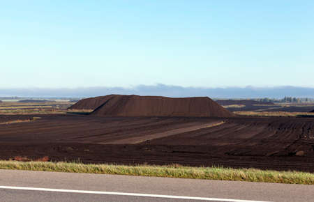quarry, where extraction is carried black peat, the summer season, the industrial production of minerals