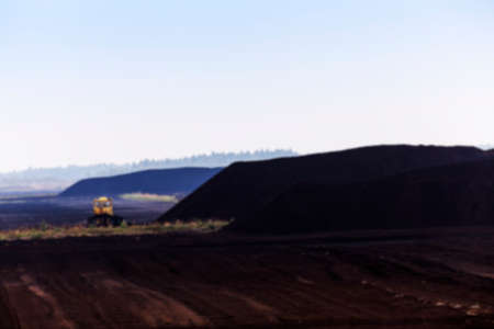 peaty: bog and the field on which the production is carried out in black peat mining, industry, defocus, old tractor Stock Photo