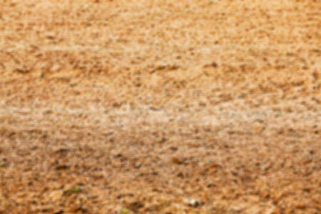 defocus: plowed for sowing new crop land is brown in color, photographed closeup defocus Stock Photo