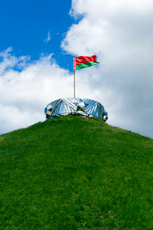 ethnical: photographed closeup of the flag of Belarus. blue sky. ragged old flag Stock Photo