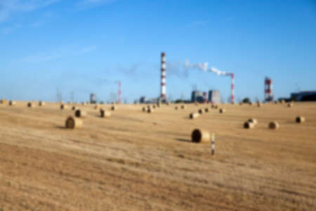 factory farm: chemical works the factory, located next to the farm field where the crop is grown, defocused
