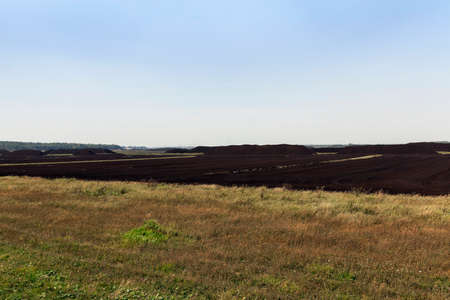 dragline: an area in which production is carried black peat, peat mountains Stock Photo
