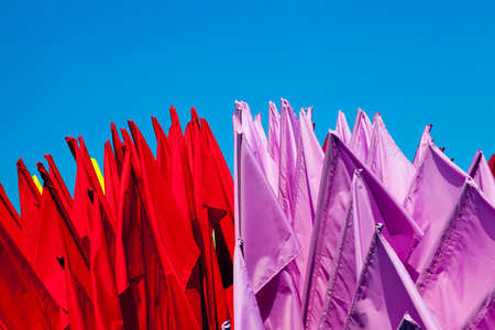 festivities: flags used to decorate the city during the festivities. Photo on a background of blue sky