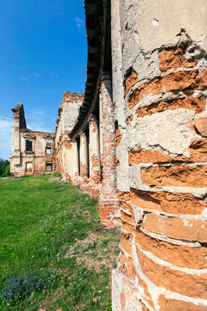 ruins of an ancient palace of the 16th century, against the blue sky, located in the village Ruzhany, the territory of the Republic of Belarus. The building is constructed of red brick Stock Photo