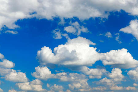 blue sky, which are floating cumulus clouds bright white. Photo taken closeup.