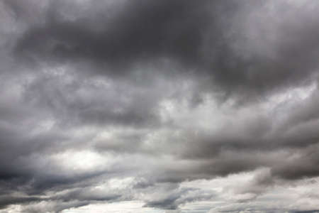 featureless: clouds photographed gray monochrome colors in cloudy weather. Autumn season Stock Photo