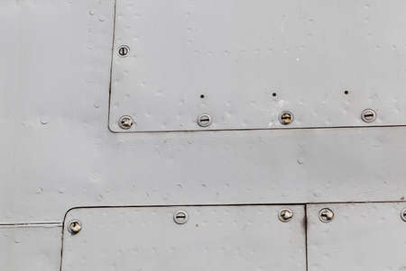 metal wall: metal surface with rivets Stock Photo