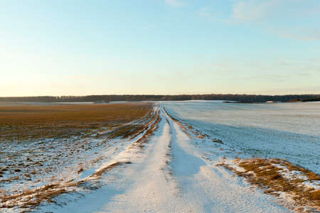 driving conditions: rural road, snow