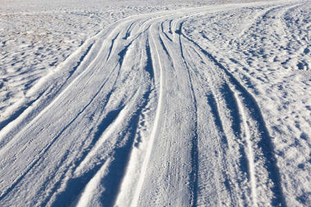 sheeted: traces of the car on snow Stock Photo
