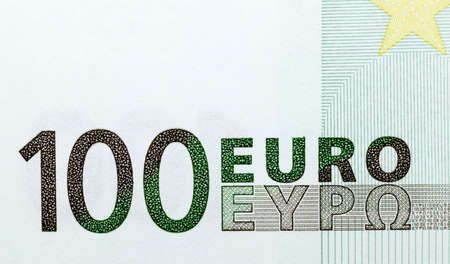 one hundred euros of the European union photographed close-up. Focus on the number one hundred 100 and the inscription of the euro Stock Photo