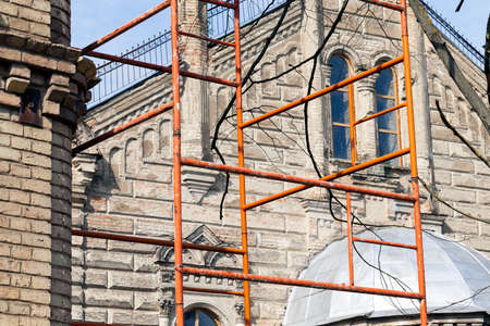 metal structure: scaffolding installed near the repaired building. Photo close up