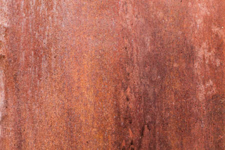 Rusty metal surface with a number of corrosive areas. Photo close-up. Part of the door to the building Stock Photo