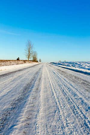 empty road with snow in winter season.