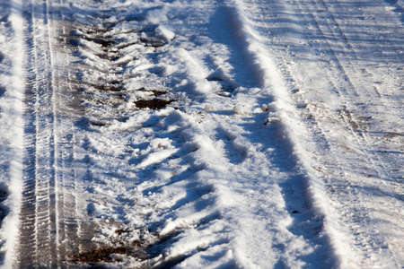 track on dirty snow from the tires of a large truck. Winter season, photo taken close-up
