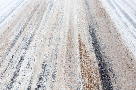 a snow-covered road in the winter season. Close-up photo Stock Photo