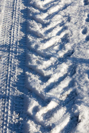 the track in the snow from the tires of a large truck. Winter time of the year, close-up
