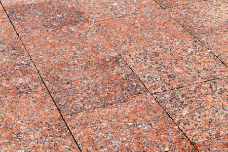 floor made of red tiles on the street. photo close-up, small depth of field Reklamní fotografie